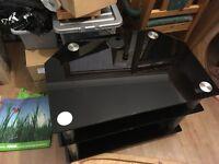 Black three tier glass TV stand