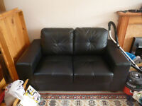 Small black two seater sofa