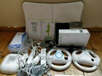 Nintendo Wii plus 27 games + wii fit board