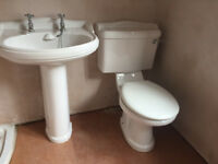 Traditional style close toilet and basin