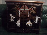 Oriental. Laquerd mother of pearl cabinet forsale