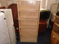 free standing pine look shelf unit.