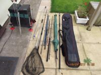 A selection of old fishing rods reels and a seat box with octoplus leg system!