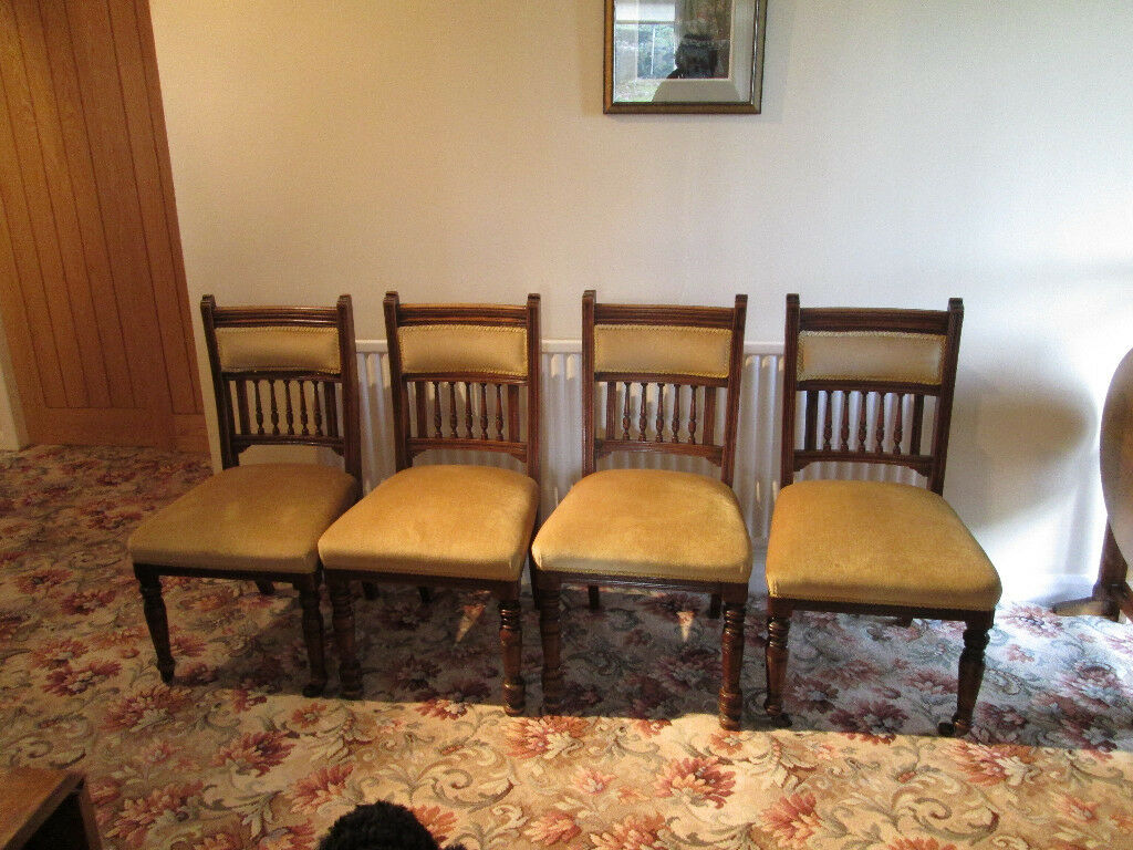 four antique oak dinning chairs