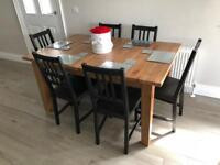 Solid oak table and 6 black chairs