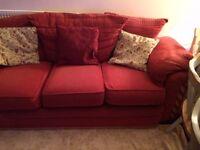 Red fabric three seater sofa