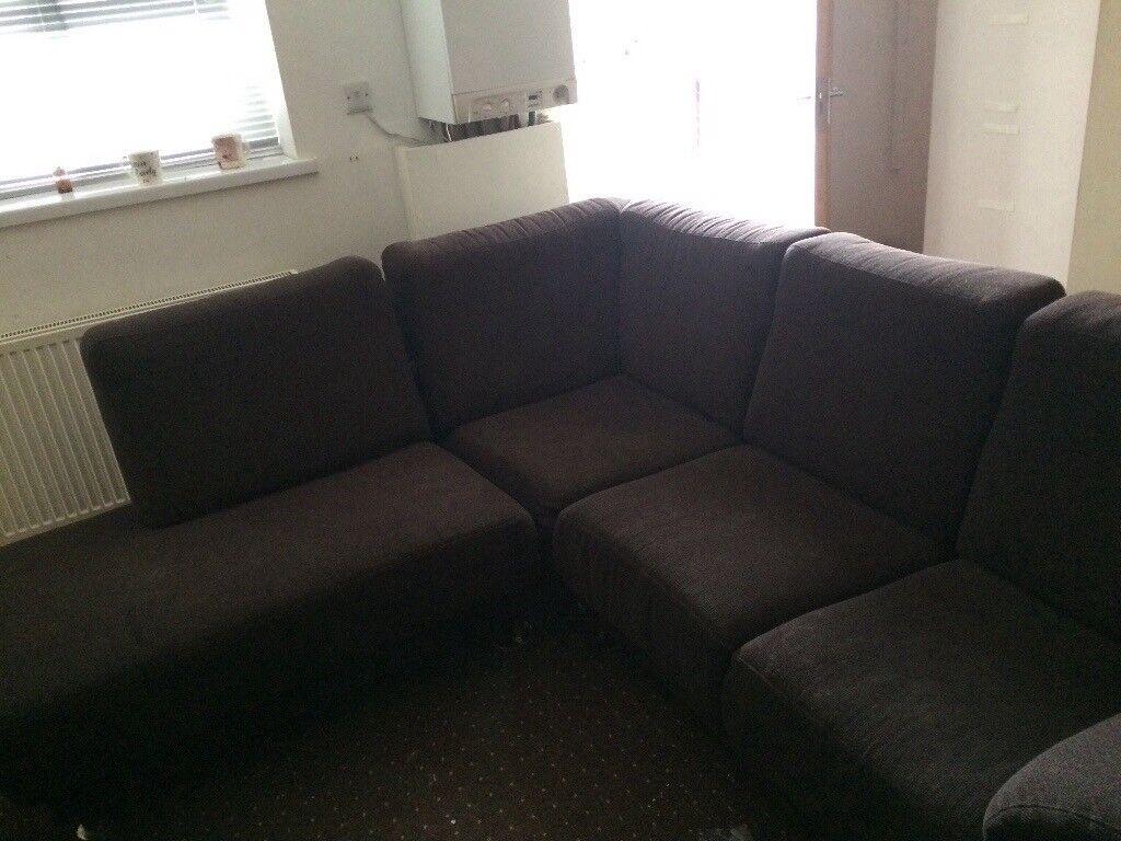 Brown material corner sofa