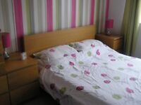 Ikea Light Oak Effect 7ft bed frame and 2 matching bedside cabinets