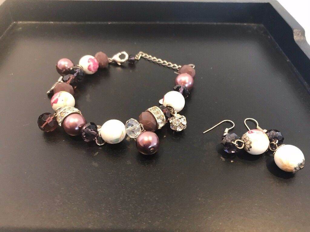 Pretty English Heritage bracelet and earrings set never been worn and in original box.