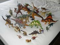 Job lot of 28 assorted plastic dinosaurs toys. Various sizes etc