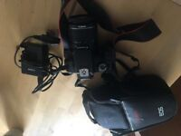 Canon EOS 1100D Digital SLR Camera (With 18-55 mm f/3.5-5.6 DC III Lens Kit)