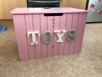 Pink grey and white toy box
