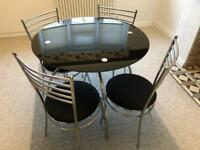Glass Table & 4 Chairs - Good Condition