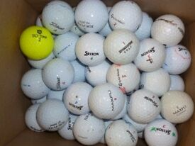 Box of 130 branded golf balls