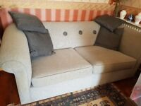 Lovely virtually new 3 seater sofa. Very comfortable. Pale grey with matching throw cushions.