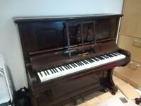 Old piano free to good home