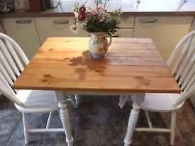 pine and white upcycled kitchen table and 2 chairs