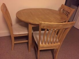 Dining Table and 4 Chairs in Good Condition - Extendable