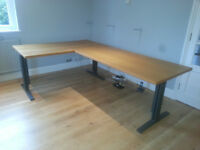 2 oak effect office tables 1500mm by 750mm incl 3 legs and 2 brackets and an office chair