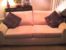 NEXT. Beige three seater sofa