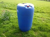 Large blue plastic barrel for sale, can be used as a water butt