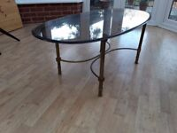 Glass coffe table with brass stand