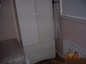 White wardrobe and matching chest of drawers for sale.