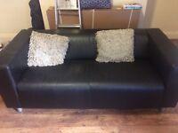 Black leather IKEA KLIPPAN sofa- less than 1 year old
