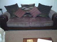 Brown leather and chenille fabric 3 seater settee and armchair.