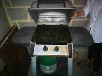 Free standing John lewis gas BBQ with stand and gas refil!