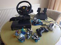 Xbox 360 with kinect, 2 controllers, skylander bundle and figures, steering wheel, 30+ games