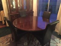 Mahogany dinning table, 60 Inches Dia (chairs not included)