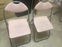 Foldable pink chairs