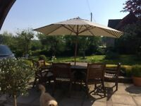 Hardwood Patio table and 6 chairs with parasol and matching seat cushions