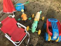 Tricycle, chair with umbrella, Playskool ride-on worm, and pull-along dump toy