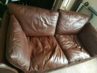 Brown leather sofa and footstool with storage