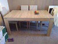 Extending table light oak no chairs