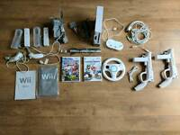 Nintendo Wii with Mario Kart, Super Smash Bros and accessories