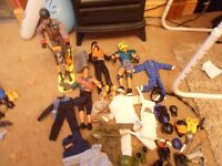 4 action men with loads of accessories boots weapons belts clothes hats