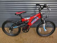 CHILDS RALEIGH ALUMINIUM SUSPENSION BIKE IN EXCELLENT ALMOST NEW CONDITION..(SUIT APPROX. AGE 6 / 7+