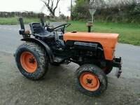 Compact tractor 4x4 with tipping trailer and tipping link box
