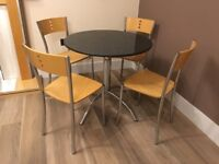 Round granite table and 4 beech/chrome chairs