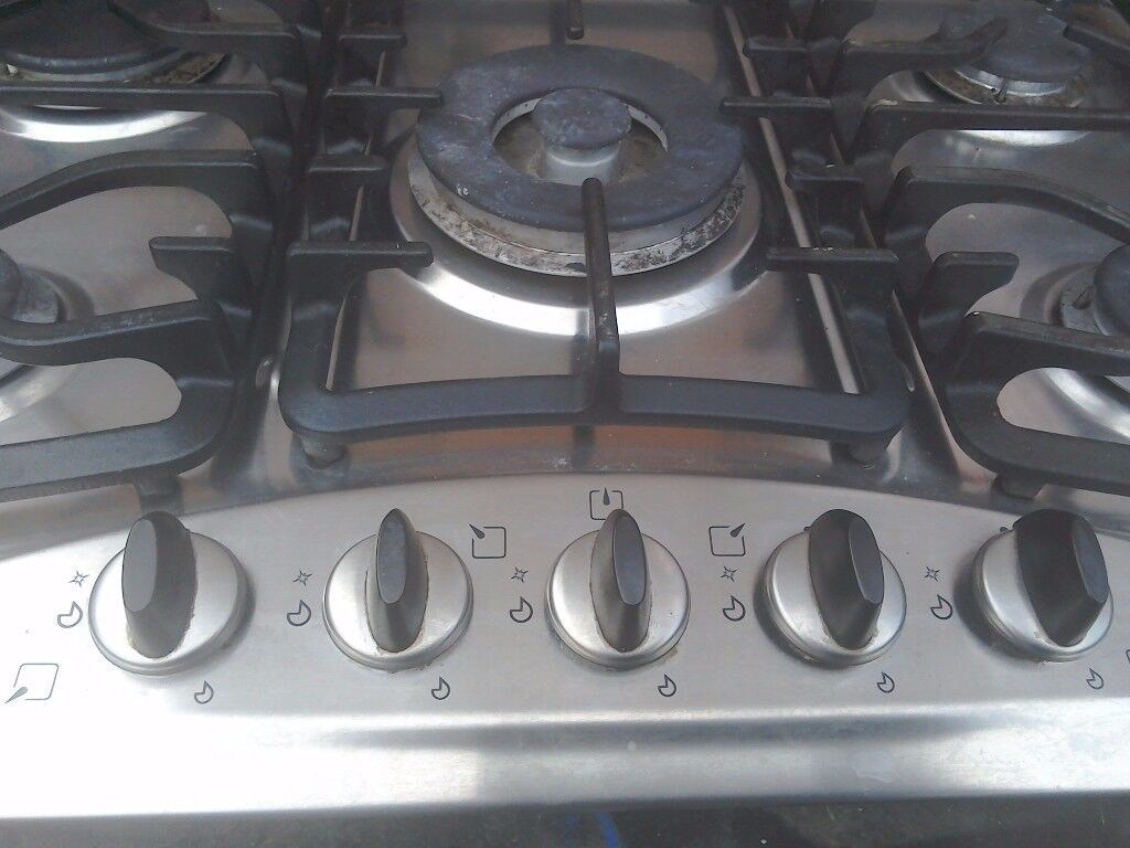 A gas hob with five gas rings stainless steal 27 inchers x20