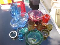 Collection of coloured glass items, jug vase bowl ornament