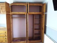 Pine built in wardrobes and chest of drawers.