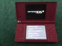 Pink Nintendo DSi with 11 games