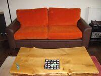 Orange cushion covers - not the sofa