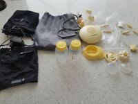 Medela Swing Breast Pump with Calma and loads of accessories plus a hand pump