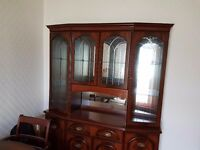 Dining table, two arm chairs, four chairs and matching unit