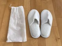 Brand new, unused white slippers with bag